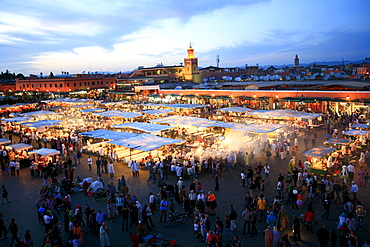 """Djemaa el-Fna, """"Square of the Hanged Man"""" in the medina quarter of Marrakech at dusk with its countless food stalls, Marrekech, Morocco, Africa"""