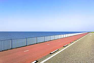 Highway with red asphalt along the sea, Holland, Netherlands, Europe