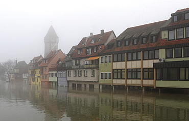 Floodwaters and fog, buildings on the bank of the Tauber river, seen from the Tauber river bridge on Bahnhofstrasse street from direction of Main estuary, Wertheim, Baden-Wuerttemberg, Germany, Europe