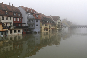 Floodwaters and fog, buildings on the bank of the Tauber river, seen from the Tauber river bridge on Bahnhofstrasse street from a southerly direction, Main estuary, Wertheim, Baden-Wuerttemberg, Germany, Europe