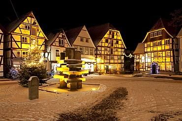 Half-timbered houses in the historic town centre with a Christmas tree and snow, Soest, Sauerland, North Rhine-Westphalia, Germany, Europe
