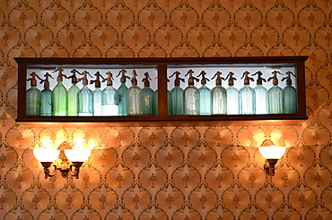 Soda syphon bottles used as a wall decoration in a cake store, Brasov, Romania, Europe