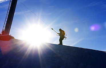 Skier being pulled by a ski lift, Gruenten ski resort, Upper Allgaeu, Swabia, Bavaria, Germany, Europe