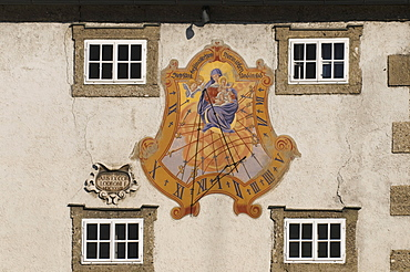 Mary and Christ child, sundial with a prayer, Steh uns bei in aller Not hier im Leben und im Tod, German for standing with us in every need here in life and in death, Salzburg, Austria, Europe