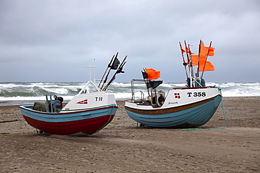 Fishing boats on the beach of Stenbjerg Landingsplads during a storm, North Sea, Thy district, northern Jutland, Jutland peninsula, Denmark, Europe
