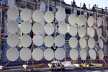 Many TV satellite dishes on a frame