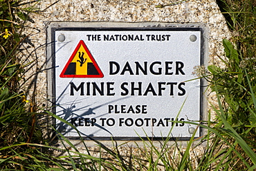 Sign warning of the danger of former mine shafts at Cape Cornwall, Cornwall, England, United Kingdom, Europe