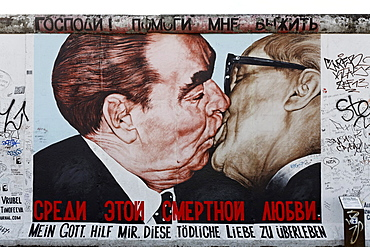 Brotherly kiss, Brezhnev kissing Honecker, painting by Dimitri Wrubel on the remants of the Berlin Wall, East Side Gallery, Friedrichshain district, Berlin, Germany, Europe