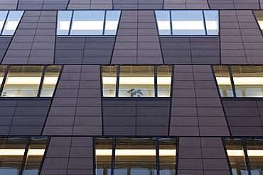 Modern facade with illuminated windows, office building in the Quartier Daimler, Potsdamer Platz, Berlin, Germany, Europe