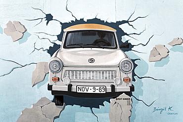 Trabant or Trabi breaking through the Berlin Wall, painting by Birgit Kinder, East Side Gallery, Friedrichshain district, Berlin, Germany, Europe