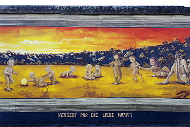 Many small naked children playing alongside their parents, painting by Henry Schmid on the remants of the Berlin Wall, East Side Gallery, Friedrichshain district, Berlin, Germany, Europe