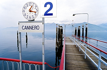 Pier with departure time clock, Cannero Riviera, Lake Maggiore, Piedmont, Italy, Europe
