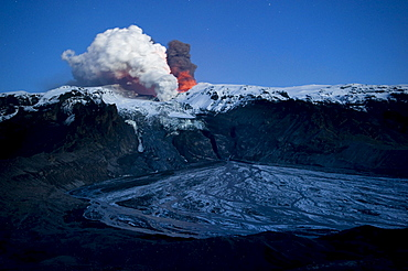 Ash cloud of the Eyjafjallajoekull volcano, steam plume from the lava flow in Gigjoekull glacier tongue, and exit point of the previous flood, Gigjoekull, Iceland, Europe