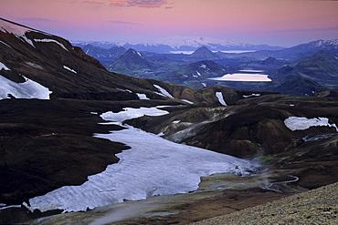 View across the Joekultungur area towards lake Alftavatn and Eyjafjallajoekull glacier as seen from Kaldaklofsfjoell mountain, Laugavegur hiking trail, Fjallabak Nature Reserve, Highlands of Iceland, Europe