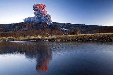 Eyjafjallajoekull volcano, the ash cloud mirroring in a small lake, fiorsmoerk, Thorsmoerk mountain ridge, Iceland, Europe