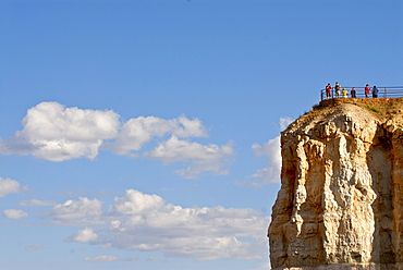 Tourists on a lookout on a hoodoo, spire of rock, in Bryce Canyon, Utah, USA