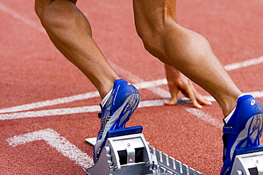Start block, hundred meter run, detail of the feet