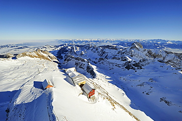 Snow-covered Alpstein massif and some mountain inns as seen from the summit of Saentis mountain, canton of Appenzell Innerrhoden, Switzerland, Europe