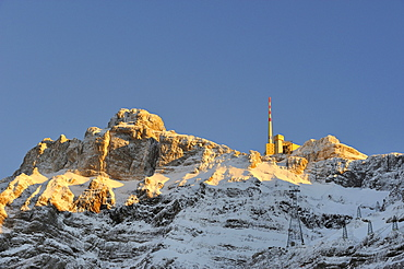 The roughly 2500m high summit of Saentis mountain in the last sunlight as seen from the north, Appenzell Alps, canton of Appenzell Innerrhoden, Switzerland, Europe