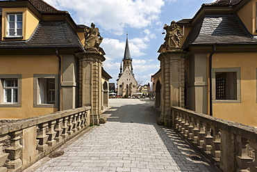 View from the gatehouse of Weikersheim Castle to St Georg town church and the marketplace of Weikersheim, Baden-Wuerttemberg, Germany, Europe