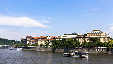 View across the Vltava River towards the historic town centre, with the Rudolfinum, the concert hall of the Czech Philharmonic Orchestra, and the Academy of Art, Prague, Czech Republic, Europe