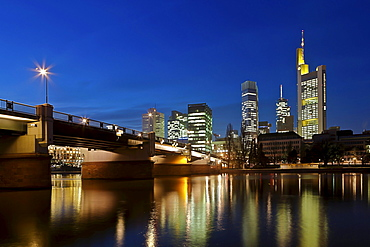 View towards Commerzbank Tower, European Central Bank, ECB, the Hessische Landesbank, Main Tower and Untermainbruecke Bridge at night, Frankfurt am Main, Hesse, Germany, Europe