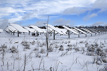 Snow-covered photovoltaic plant, Oberruesselbach, Middle Franconia, Bavaria, Germany, Europe