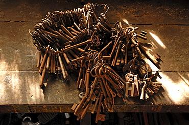 Rusty door keys lying on a workbench