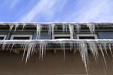 Icicles on the eaves of a hotel, Schlossberg Osternohe, Middle Franconia, Bavaria, Germany, Europe