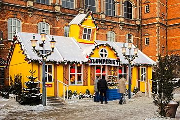 Yellow snow-covered house in Tivoli, Copenhagen, Denmark, Europe