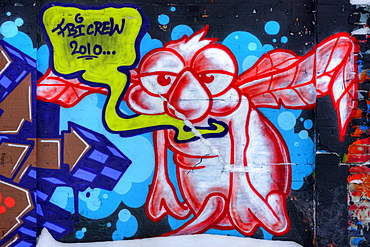 Graffiti, extraterrestrial alien, on a wall