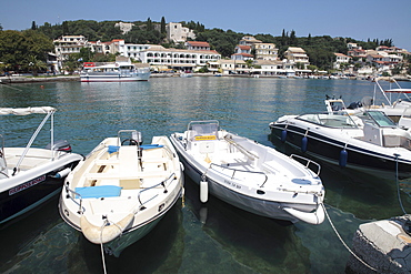Boats moored in the harbour of Kassiopi, Corfu, Greece, Europe