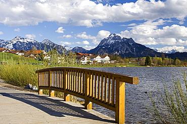 Wood bridge on Lake Hopfensee, Hopfen am See, Bavaria, Germany, Europe