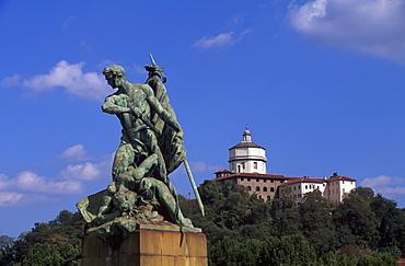 Statue on the bridge Ponte Umberto I and Church of Santa Maria del Monte in Turin, Torino, Piedmont, Italy, Europe