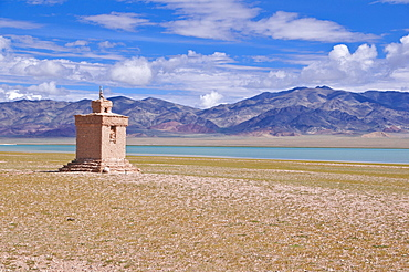 Chorten beside a high mountain lake along the road from Gerze to Tsochen, Western Tibet, Tibet, Asia