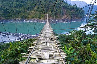 Long suspension bridge made of palm wood spanning the Siang River, Arunachal Pradesh, North East India, India, Asia
