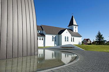 Church and reflection in water, Keflavik, Iceland, Scandinavia, Northern Europe, Europe