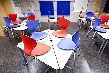 Chairs on desks in a classroom in a school in Straubing, Bavaria, Germany, Europe