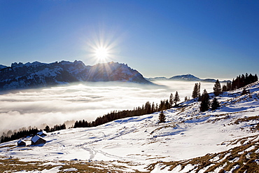 Appenzell region, Alpstein massif and an alpine pasture as seen from Faehnerenspitze mountain, low stratus and thaw, Swiss Alps, Switzerland, Europe