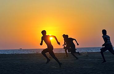 Young men playing football on the beach, Negombo, Sri Lanka, Ceylon, South Asia, Asia