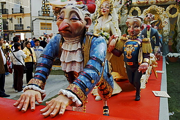 Woman dominating a man, footmen rolling out the red carpet, crude carnival characters and satirical sculptures at a parade, Fallas festival, Falles festival in Valencia in early spring, Spain, Europe