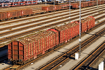 Waggons with tree trunks, through station and switch yard Munich Nord, Munich, Bavaria, Germany, Europe