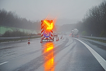 Bright traffic sign, road works, route diversion, sign, rain, fog, bad weather, poor visibility, traffic, A 45 motorway, Sauerland area, North Rhine-Westphalia, Germany, Europe