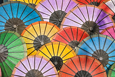 Multicoloured hand made paper umbrellas or parasols on sale at the handicraft evening market in Luang Prabang, Laos, Southeast Asia