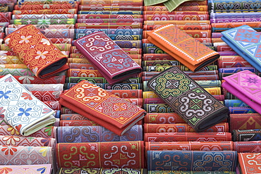 Colourful traditional wallets on display at a market stall in Luang Prabang, Laos, Southeast Asia