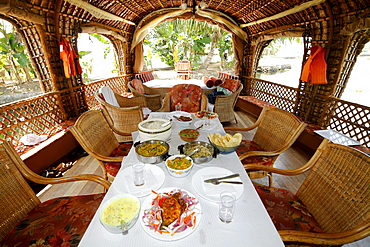 Dining table on a luxury houseboat on a canal, Haripad, Alappuzha, Alleppey, Kerala, India, Asia