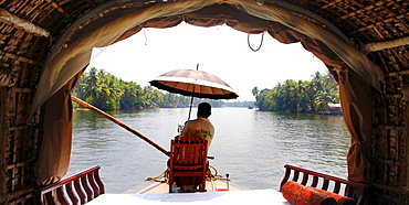 Skipper, helmsman, of a houseboat on a canal, Haripad, Alappuzha, Alleppey, Kerala, India, Asia