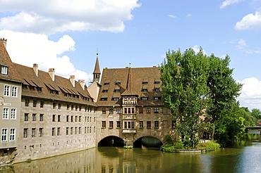 Heilig Geist Spital Hospital of the Holy Spirit on the river Pegnitz, Nuremberg, Middle Franconia, Bavaria, Germany, Europe