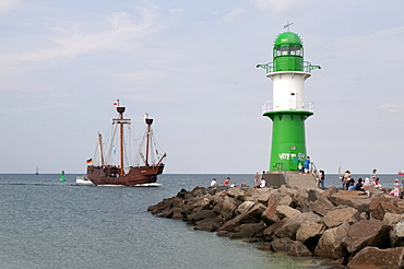 Historic sailing ship and the lighthouse at the harbour entrance, Hanse Sail, a maritime festival, Warnemuende district, Rostock, Mecklenburg-Western Pomerania, Germany, Europe