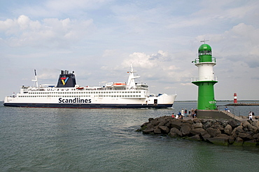 Scandlines ferry and the lighthouse at the harbour entrance, Warnemuende district, Rostock, Mecklenburg-Western Pomerania, Germany, Europe